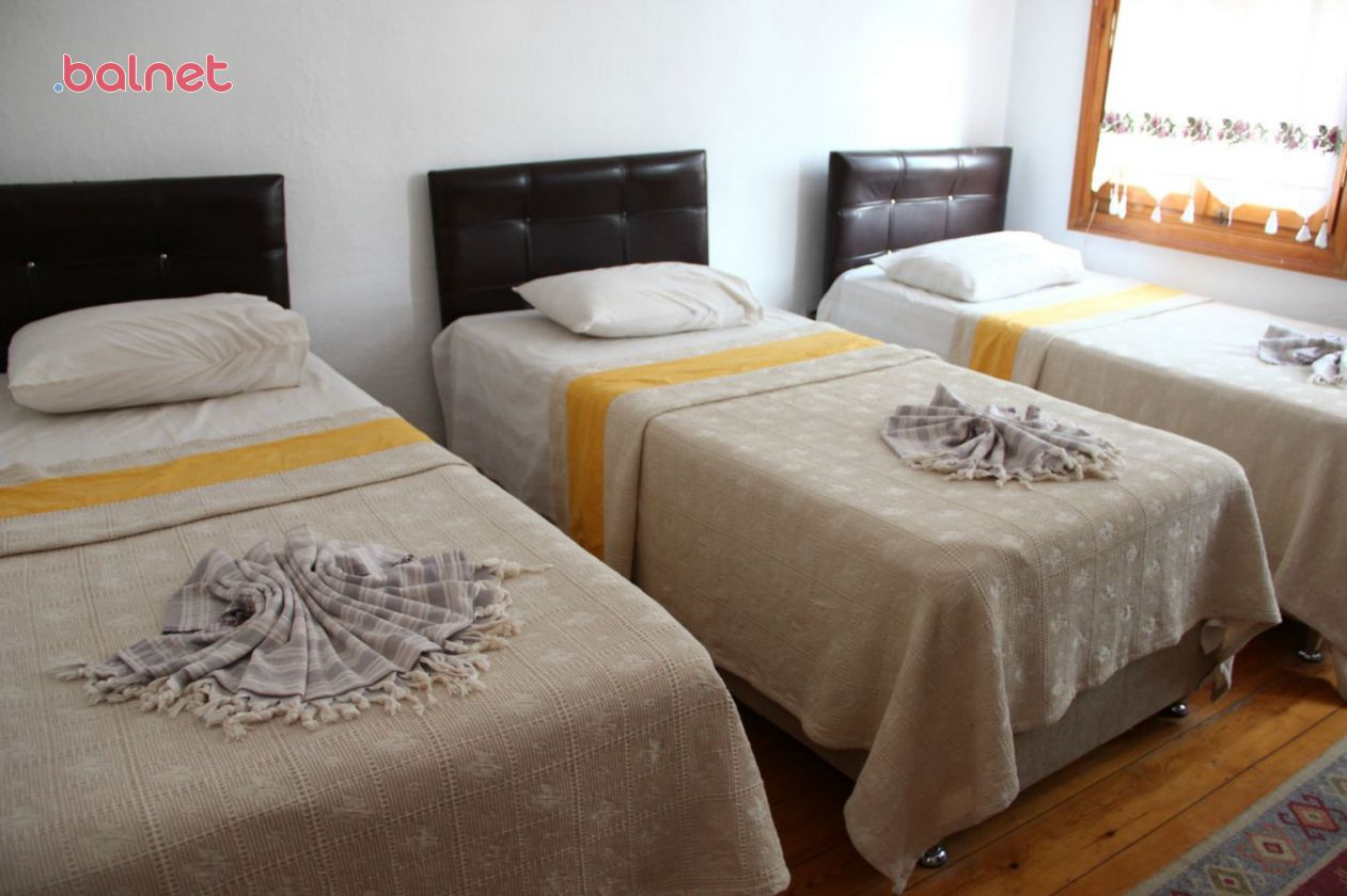 Üç Kişilik Tek Yataklı Odalarımız